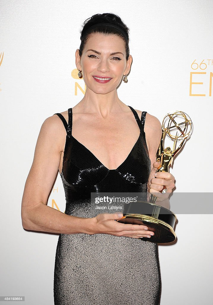 Actress <a gi-track='captionPersonalityLinkClicked' href=/galleries/search?phrase=Julianna+Margulies&family=editorial&specificpeople=208994 ng-click='$event.stopPropagation()'>Julianna Margulies</a> poses in the press room at the 66th annual Primetime Emmy Awards at Nokia Theatre L.A. Live on August 25, 2014 in Los Angeles, California.