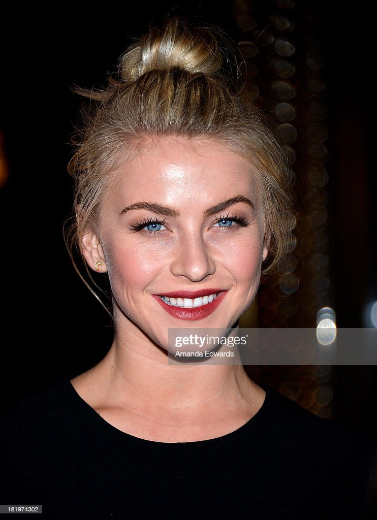 Actress Julianne Hough arrives at the Escada and W Magazine shopping event benefiting the Cool Earth Organization at Escada Boutique on September 26, 2013 in Beverly Hills, California.