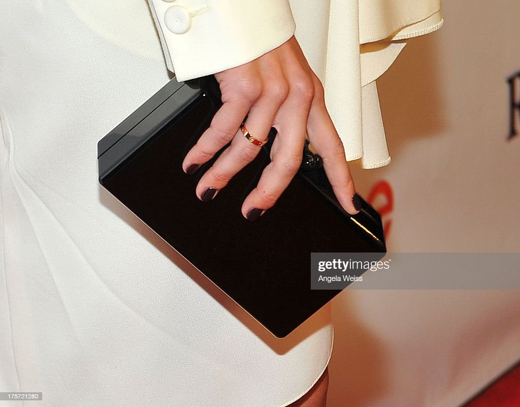 Actress Julianne Hough (purse detail) arrives at the premiere of DirecTV's 'Paradise' at Mann Chinese 6 on August 6, 2013 in Los Angeles, California.