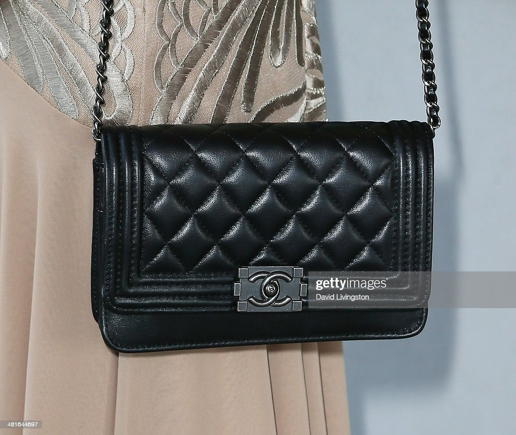 Actress Julianne Michelle (purse detail) attends the Los Angeles premiere of 'Awakened' at the Laemmle Music Hall on March 30, 2014 in Beverly Hills, California.