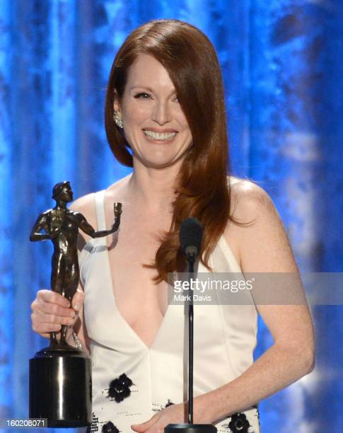 Actress Julianne Moore accepts the award for Outstanding Performance by a Female Actor in a Television Movie or Miniseries for 'Game Change' onstage...
