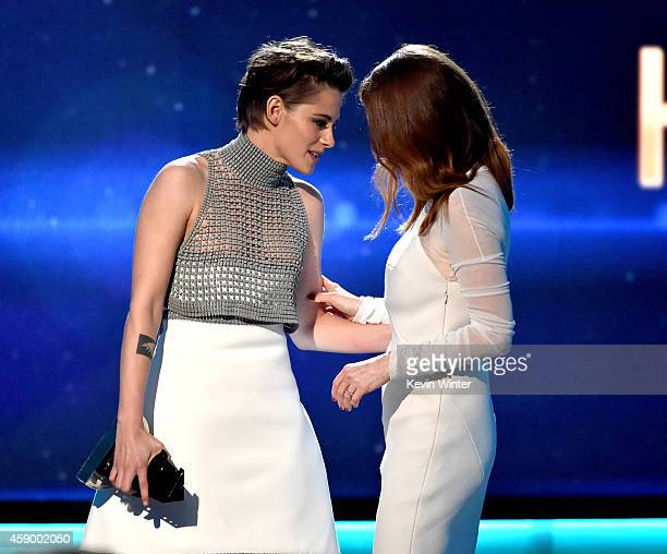 Actress Julianne Moore accepts the Hollywood Actress Award for 'Still Alice' from actress Kristen Stewart onstage during the 18th Annual Hollywood...