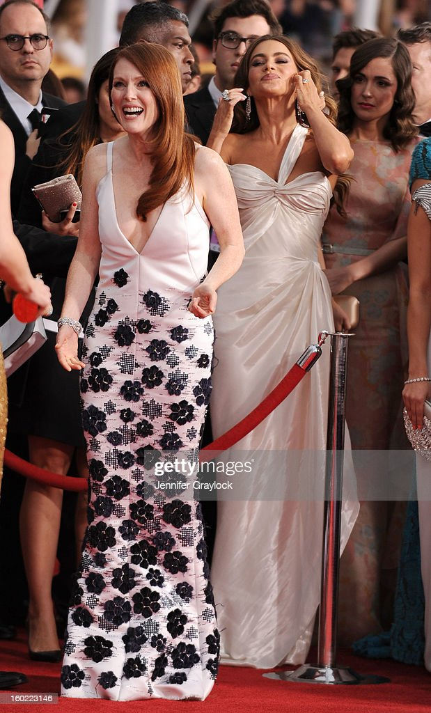 Actress Julianne Moore and Actress Sofia Vergara arrive at the 19th Annual Screen Actors Guild Awards held at The Shrine Auditorium on January 27, 2013 in Los Angeles, California.