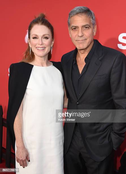 Actress Julianne Moore and executive producer/director George Clooney arrive at the premiere of Paramount Pictures' 'Suburbicon' at the Village...