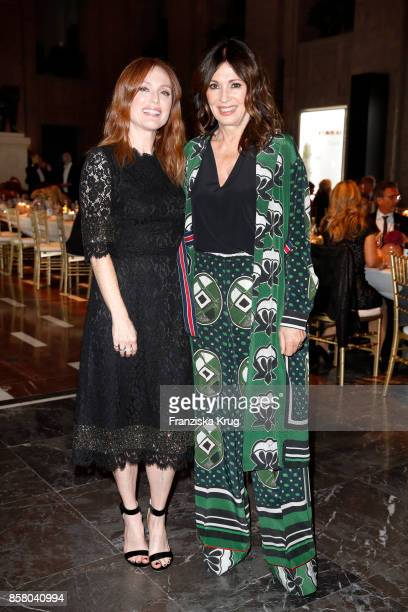 US actress Julianne Moore and german actress Iris Berben attend the Florale By Triumph Dinner Hosted By Julianne Moore at Altes Stadthaus on October...