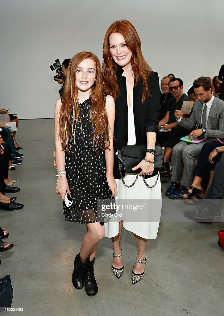 Actress <a gi-track='captionPersonalityLinkClicked' href=/galleries/search?phrase=Julianne+Moore&family=editorial&specificpeople=171555 ng-click='$event.stopPropagation()'>Julianne Moore</a> and her daughter Liv Helen Freundlich (L) attend the Reed Krakoff fashion show during Mercedes-Benz Fashion Week Spring 2014 on September 11, 2013 in New York City.
