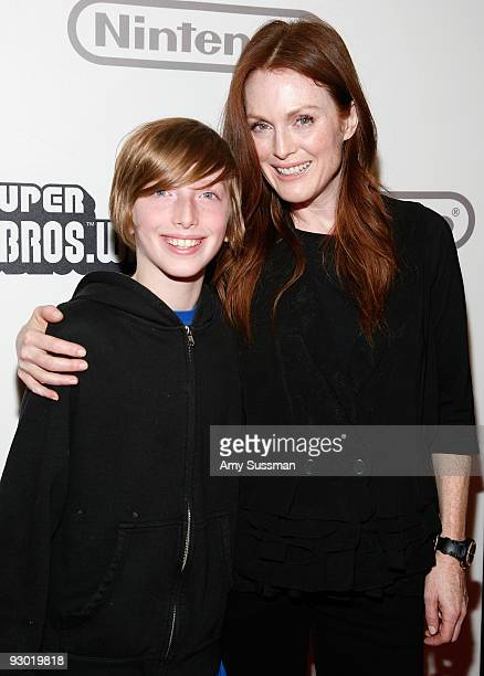 Actress Julianne Moore and her son Caleb Freundlich attends the 25 years of Mario celebration at the Nintendo World Store on November 12 2009 in New...