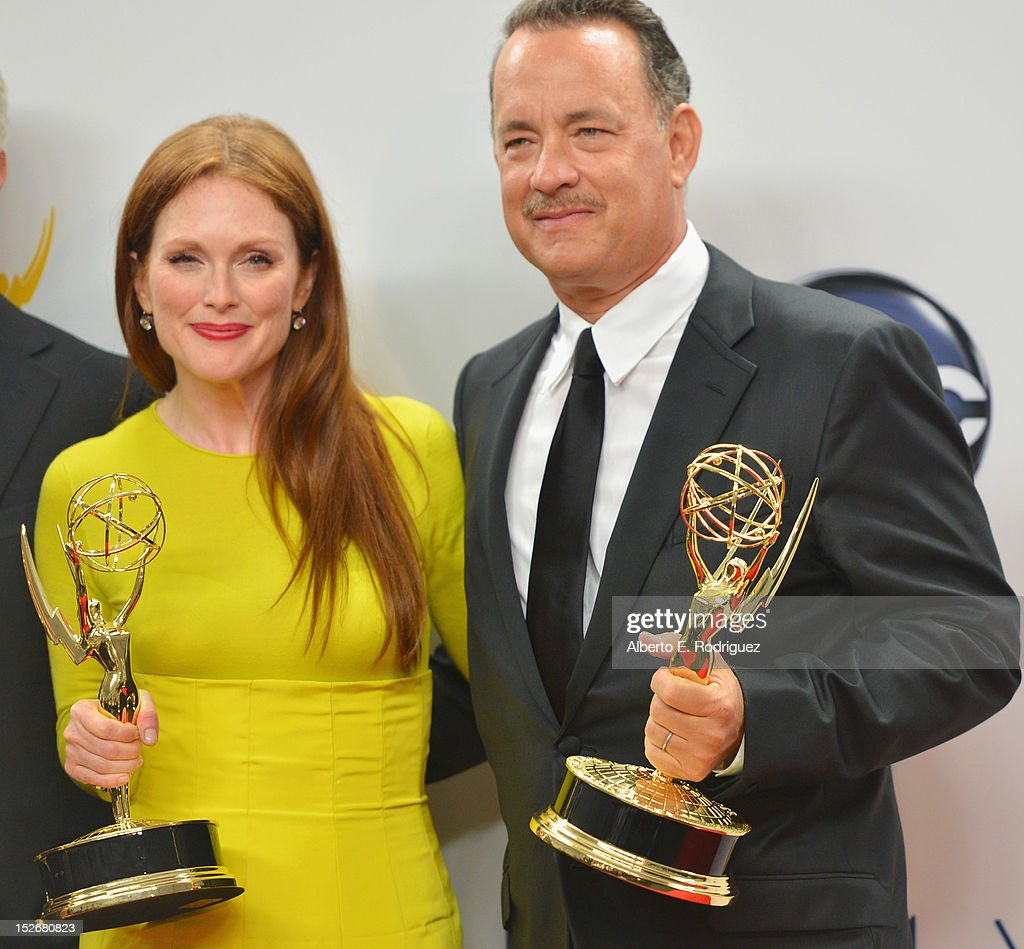 Actress <a gi-track='captionPersonalityLinkClicked' href=/galleries/search?phrase=Julianne+Moore&family=editorial&specificpeople=171555 ng-click='$event.stopPropagation()'>Julianne Moore</a> and producer <a gi-track='captionPersonalityLinkClicked' href=/galleries/search?phrase=Tom+Hanks&family=editorial&specificpeople=201790 ng-click='$event.stopPropagation()'>Tom Hanks</a> pose in the 64th Annual Emmy Awards press room at Nokia Theatre L.A. Live on September 23, 2012 in Los Angeles, California.