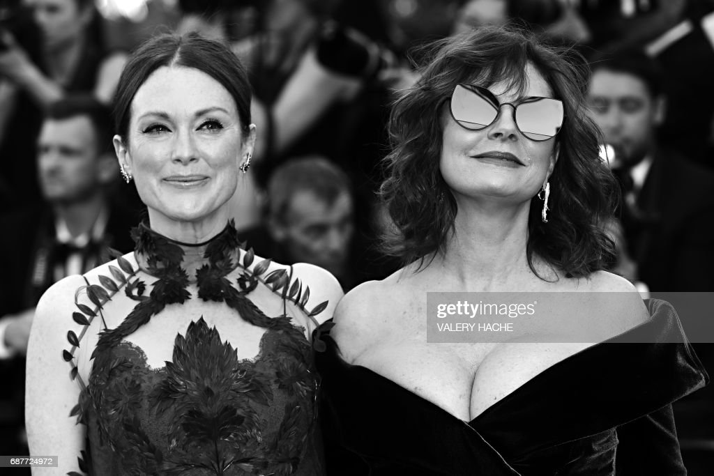 US actress Julianne Moore (L) and US actress Susan Sarandon pose as they arrive on May 17, 2017 for the screening of the film 'Ismael's Ghosts' (Les Fantomes d'Ismael) during the opening ceremony of the 70th edition of the Cannes Film Festival in Cannes, southern France. / AFP PHOTO / Valery HACHE