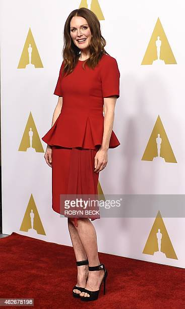 Actress Julianne Moore arrives for the Oscars Nominees' Luncheon hosted by the Academy of Motion Picture Arts and Sciences February 2 2015 at the...