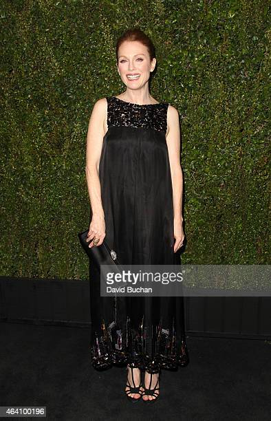 Actress Julianne Moore attends the Chanel and Charles Finch PreOscar Dinner at Madeo Restaurant on February 21 2015 in Los Angeles California