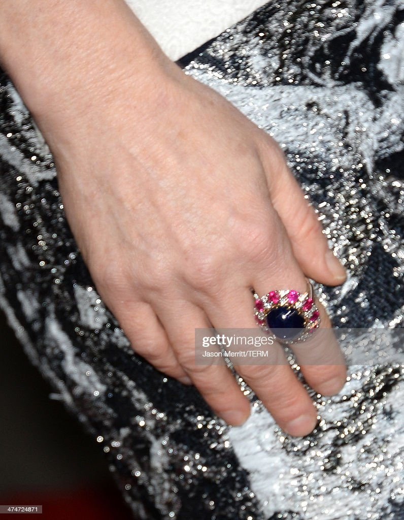 Actress Julianne Moore (jewelry detail) attends the premiere of Universal Pictures and Studiocanal's 'Non-Stop' at Regency Village Theatre on February 24, 2014 in Westwood, California.