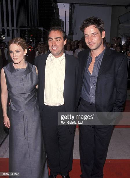Actress Julianne Moore director Oliver Parker and actor Jeremy Northam attend 'An Ideal Husband' New York City Premiere on June 16 1999 at the Paris...