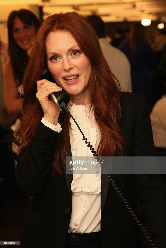 Actress <a gi-track='captionPersonalityLinkClicked' href=/galleries/search?phrase=Julianne+Moore&family=editorial&specificpeople=171555 ng-click='$event.stopPropagation()'>Julianne Moore</a> fundraises at the Annual Charity Day Hosted By Cantor Fitzgerald And BGC at the Cantor Fitzgerald Office on September 11, 2013 in New York, United States.