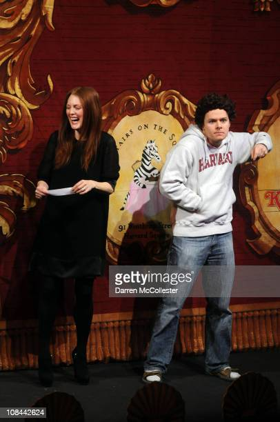 Actress Julianne Moore performs in a skit with a Hasty Pudding Theatrical cast member dressed as Mark Zuckerberg prior to receiving the Hasty Pudding...