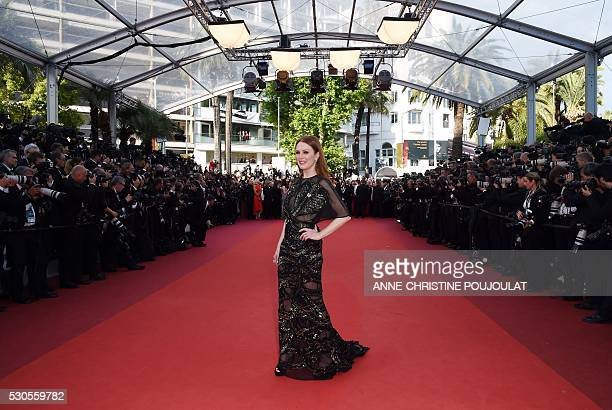 US actress Julianne Moore poses as she arrives on May 11 2016 for the opening ceremony of the 69th Cannes Film Festival in Cannes southern France /...