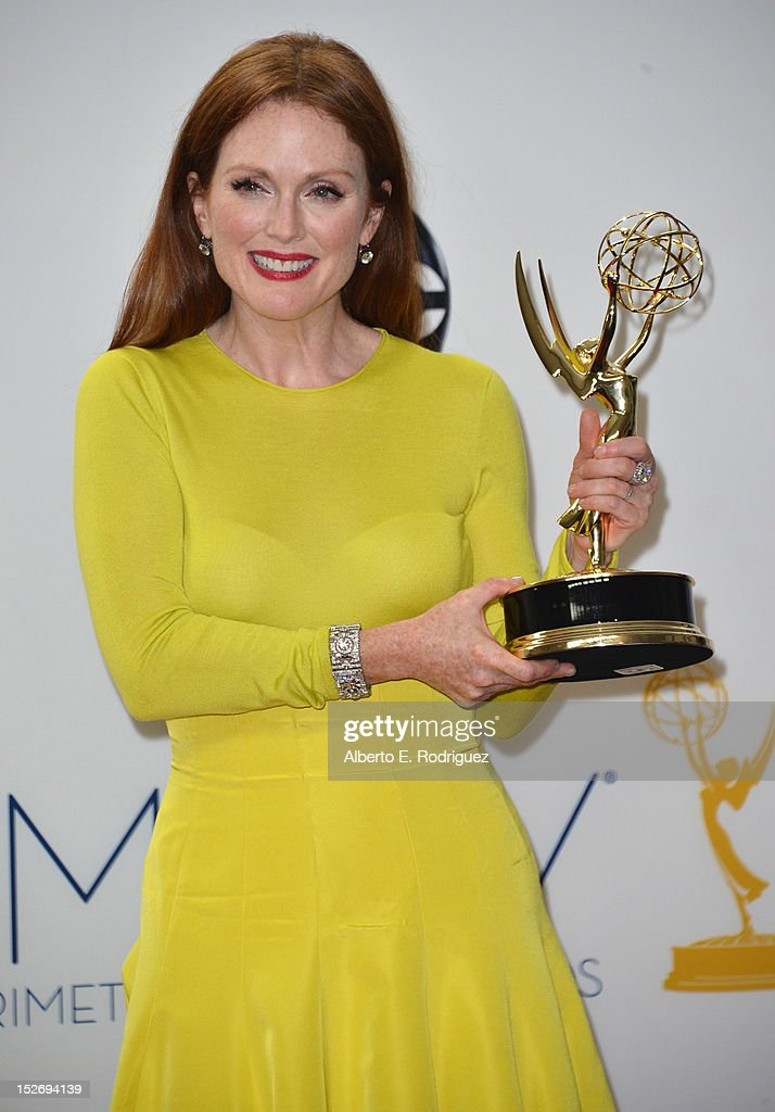 Actress <a gi-track='captionPersonalityLinkClicked' href=/galleries/search?phrase=Julianne+Moore&family=editorial&specificpeople=171555 ng-click='$event.stopPropagation()'>Julianne Moore</a> poses in the 64th Annual Emmy Awards press room at Nokia Theatre L.A. Live on September 23, 2012 in Los Angeles, California.