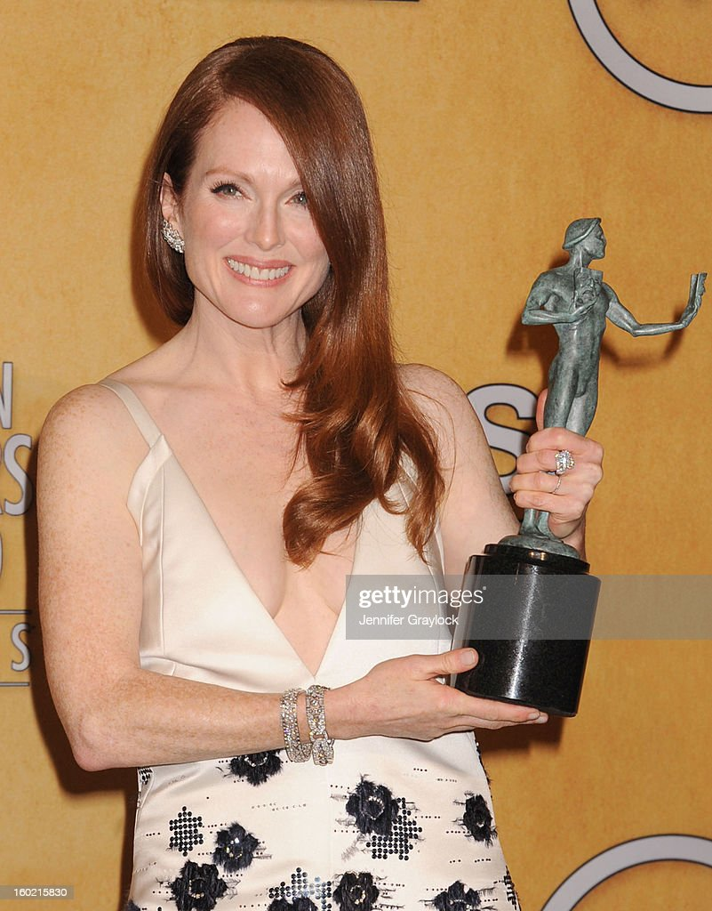 Actress <a gi-track='captionPersonalityLinkClicked' href=/galleries/search?phrase=Julianne+Moore&family=editorial&specificpeople=171555 ng-click='$event.stopPropagation()'>Julianne Moore</a> poses in the press room at the 19th Annual Screen Actors Guild Awards at The Shrine Auditorium on January 27, 2013 in Los Angeles, California.