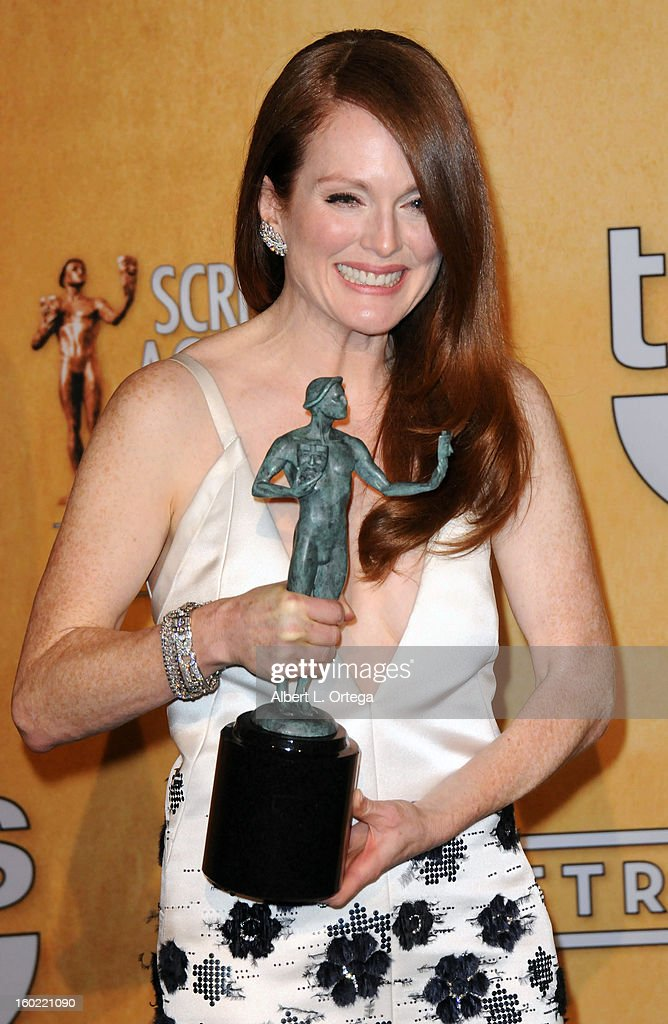 Actress <a gi-track='captionPersonalityLinkClicked' href=/galleries/search?phrase=Julianne+Moore&family=editorial&specificpeople=171555 ng-click='$event.stopPropagation()'>Julianne Moore</a> poses in the press room at the 19th Annual Screen Actors Guild Awards held at The Shrine Auditorium on January 27, 2013 in Los Angeles, California.
