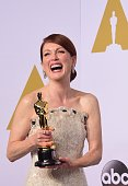 Actress Julianne Moore winner for the Best Actress in a Leading Role Award for 'Still Alice' arrives in the press room during the 87th Oscars on...