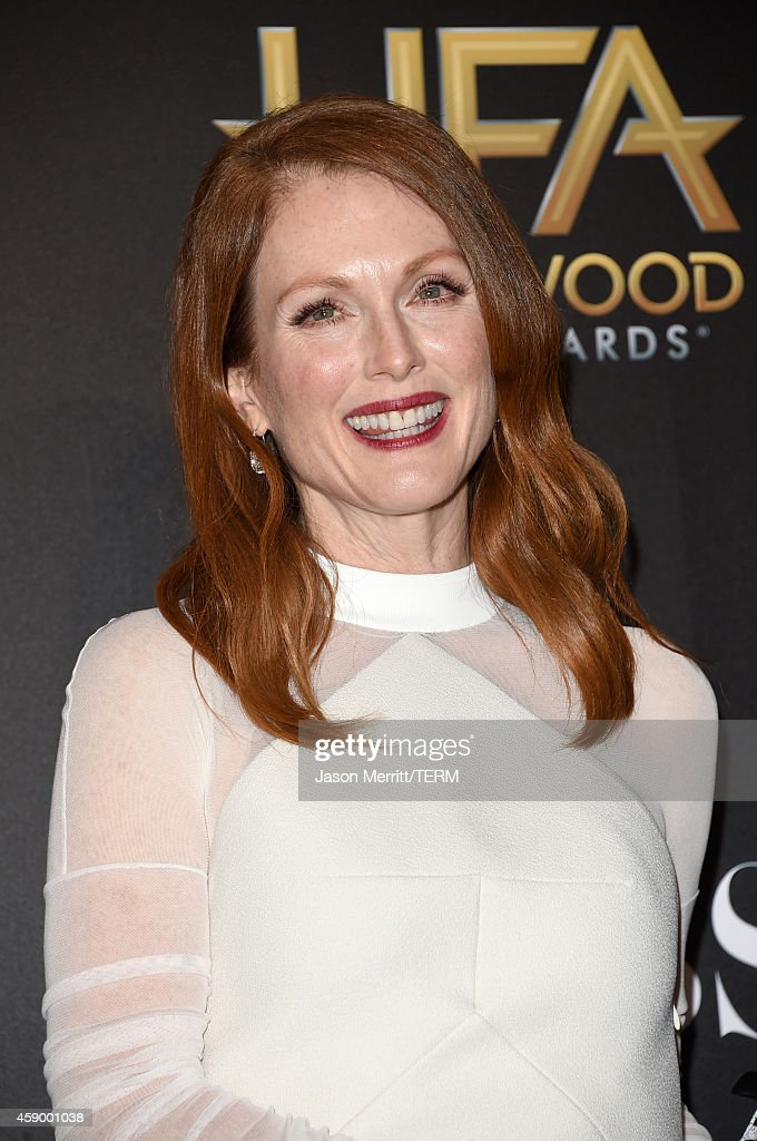 Actress Julianne Moore, winner of Hollywood Actress for 'Still Alice,' poses in the press room during the 18th Annual Hollywood Film Awards at The Palladium on November 14, 2014 in Hollywood, California.