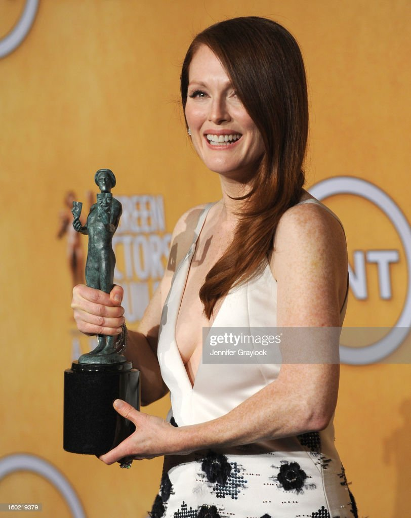 Actress <a gi-track='captionPersonalityLinkClicked' href=/galleries/search?phrase=Julianne+Moore&family=editorial&specificpeople=171555 ng-click='$event.stopPropagation()'>Julianne Moore</a>, winner of Outstanding Performance by a Female Actor in a Television Movie or Miniseries for 'Game Change', poses in the press room during the 19th Annual Screen Actors Guild Awards held at The Shrine Auditorium on January 27, 2013 in Los Angeles, California.