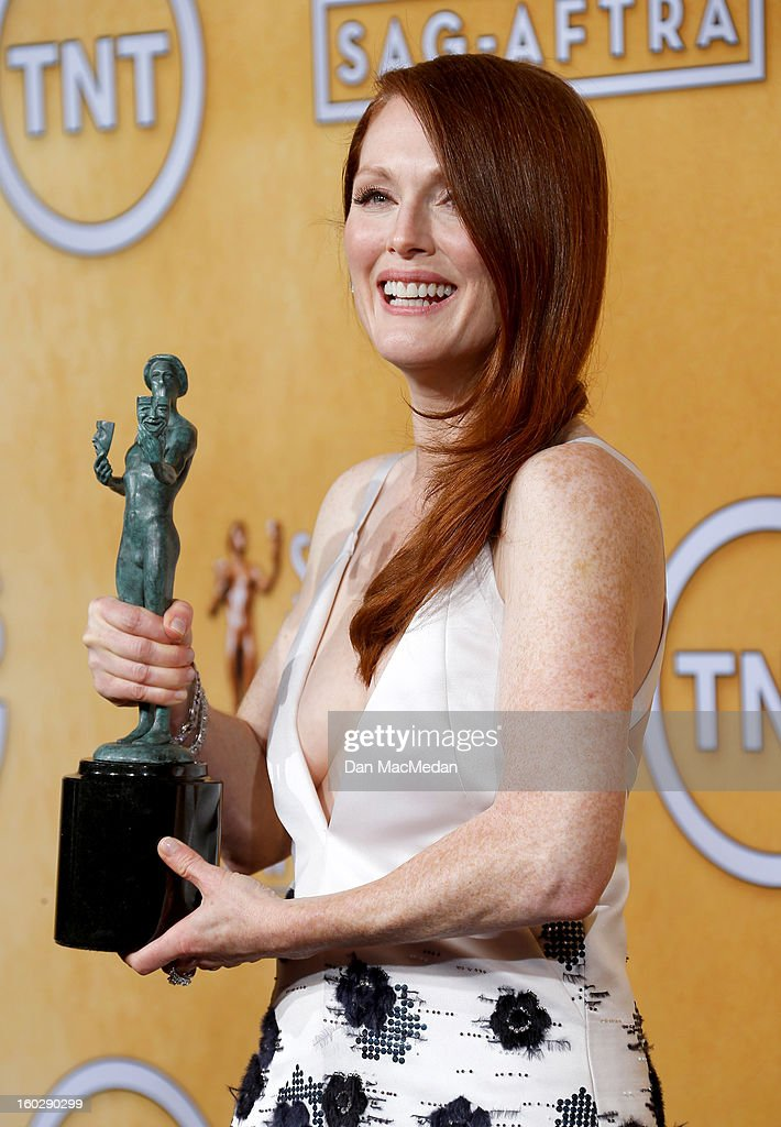Actress <a gi-track='captionPersonalityLinkClicked' href=/galleries/search?phrase=Julianne+Moore&family=editorial&specificpeople=171555 ng-click='$event.stopPropagation()'>Julianne Moore</a>, winner of Outstanding Performance by a Female Actor in a Television Movie or Miniseries for 'Game Change', poses in the press room at the 19th Annual Screen Actors Guild Awards at the Shrine Auditorium on January 27, 2013 in Los Angeles, California.