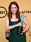 Actress Julianne Moore winner of Outstanding Performance by a Female Actor in a Leading Role for 'Still Alice' poses in the press room at the 21st...