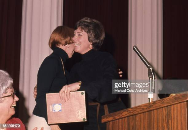 Actress Julie Andrews attends an event with 2 men in circa 1973