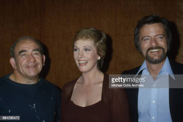 Actress Julie Andrews attends an event with 2 men in circa 1975