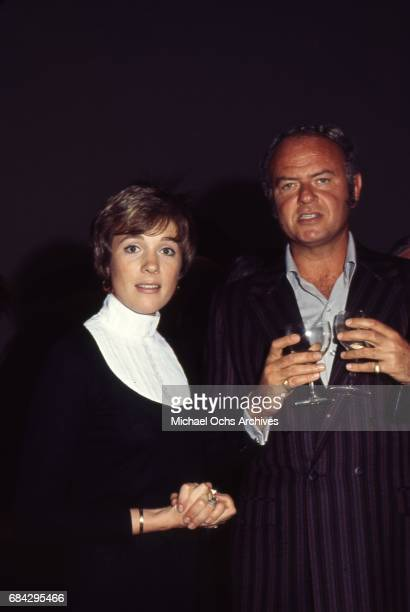 Actress Julie Andrews attends an event with a man in circa 1971