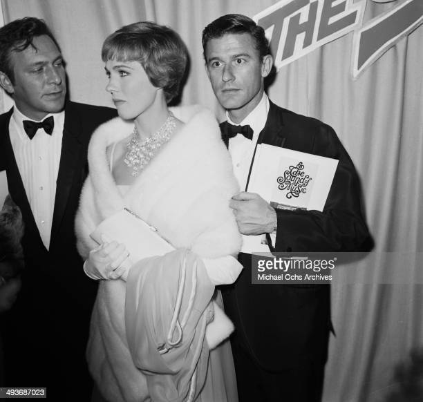 Actress Julie Andrews with actor Christopher Plummer and Roddy McDowall attend the premiere of 'Sound of Music' in Los Angeles California