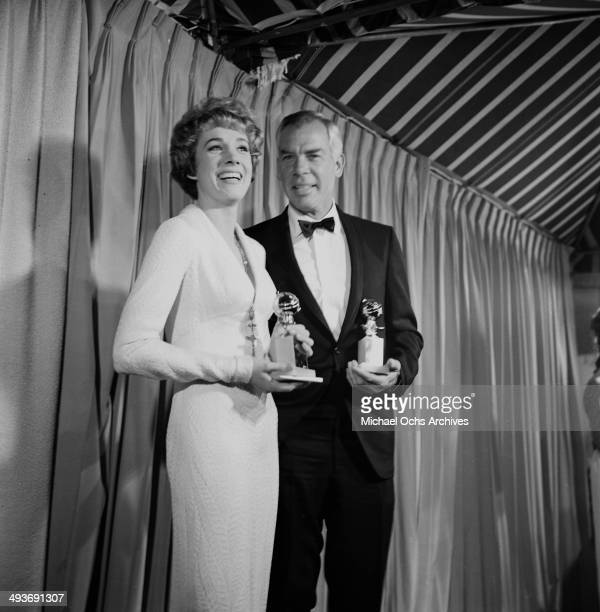 Actress Julie Andrews with actor Lee Marvin pose with Golden Globes Golden Globe Award for Best Actress and Actor in Los Angeles California