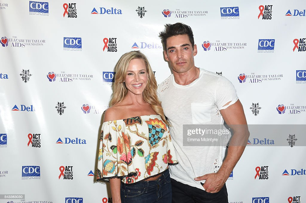 Actress <a gi-track='captionPersonalityLinkClicked' href=/galleries/search?phrase=Julie+Benz&family=editorial&specificpeople=217554 ng-click='$event.stopPropagation()'>Julie Benz</a> (L) and actor/model Nick Hounslow attend 'The Elizabeth Taylor AIDS Foundation Hosts HIV Testing' at The Abbey on June 27, 2016 in West Hollywood, California.