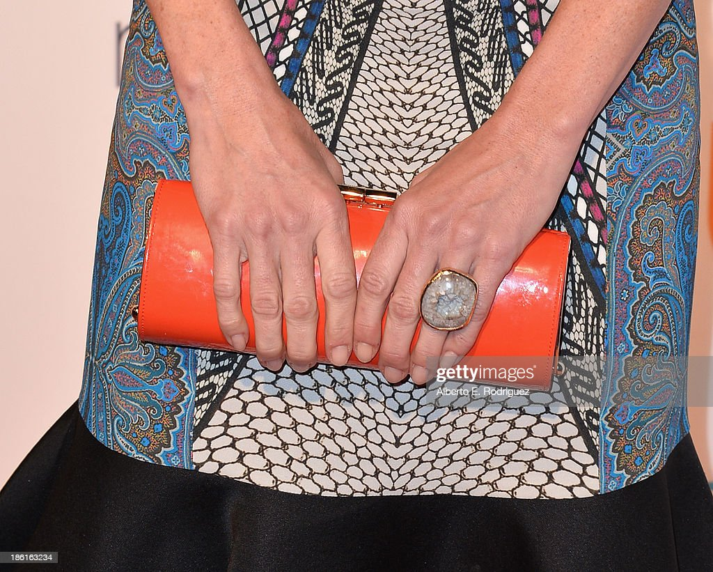 Actress Julie Bowen (purse detail) attends USA Network's 'Modern Family' fan appreciation day at Westwood Village on October 28, 2013 in Los Angeles, California.
