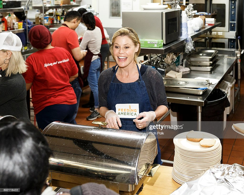 Actress Julie Bowen volunteers at The Downtown Women's Center as part of Feeding America's 'Hope for the Holidays' at Downtown Women's Center on...
