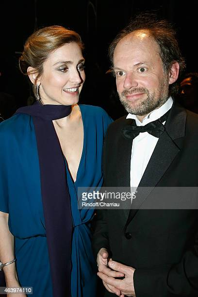 Actress Julie Gayet and actor Denis Podalydes pose backstage during the 40th Cesar Film Awards 2015 at Theatre du Chatelet on February 20 2015 in...