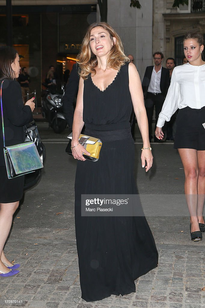 Actress <a gi-track='captionPersonalityLinkClicked' href=/galleries/search?phrase=Julie+Gayet&family=editorial&specificpeople=221651 ng-click='$event.stopPropagation()'>Julie Gayet</a> arrives to attend the 'The Glory of Water' Karl Lagerfeld's exhibition at FENDI store on Avenue Montaigne on July 3, 2013 in Paris, France.