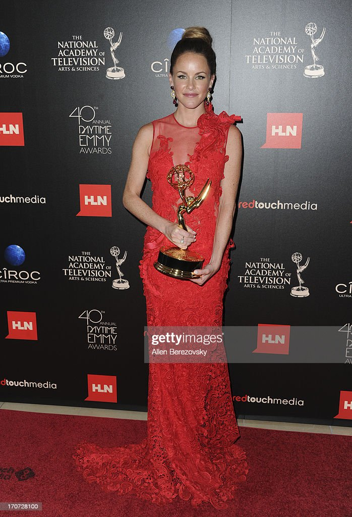 Actress Julie Marie Berman poses with the Outstanding Supporting Actress In A Drama Series award for 'General Hospital' attends 40th Annual Daytime Entertaimment Emmy Awards at The Beverly Hilton Hotel on June 16, 2013 in Beverly Hills, California.