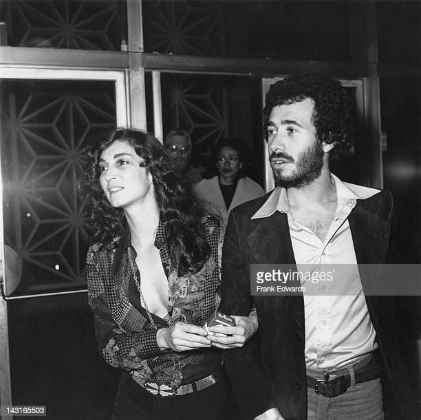 Actress Julie Payne with producer David Geffen at a screening of the film 'Shampoo' USA 4th February 1975