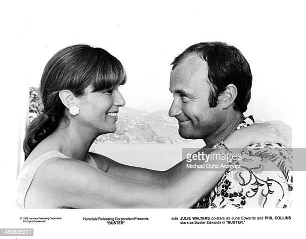 Actress Julie Walters and actor Phil Collins on set of the movie 'Buster ' circa 1988
