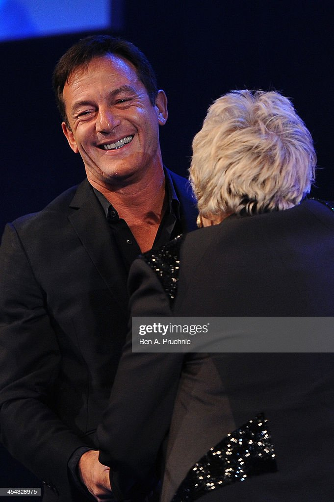 Actress Julie Walters receives the Richard Harris Award from actor Jason Isaacs as they attend the ceremony for the Moet British Independent Film Awards at Old Billingsgate Market on December 8, 2013 in London, England.