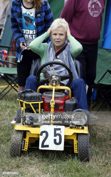 Actress Julie Walters tries out one of the mowers in the British Lawn Mower Racing Association 12 hour British Lawn mower endurance race near...