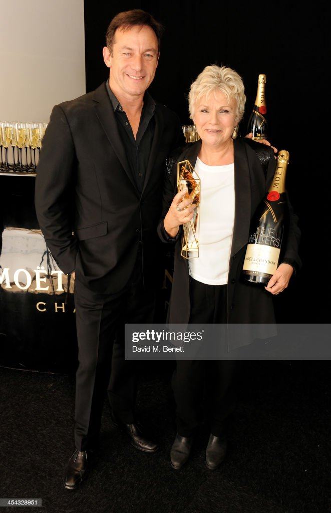 Actress <a gi-track='captionPersonalityLinkClicked' href=/galleries/search?phrase=Julie+Walters&family=editorial&specificpeople=206570 ng-click='$event.stopPropagation()'>Julie Walters</a> (R), winner of the Richard Harris Award, poses with presenter <a gi-track='captionPersonalityLinkClicked' href=/galleries/search?phrase=Jason+Isaacs&family=editorial&specificpeople=212740 ng-click='$event.stopPropagation()'>Jason Isaacs</a> backstage at the Moet British Independent Film Awards 2013 at Old Billingsgate Market on December 8, 2013 in London, England.