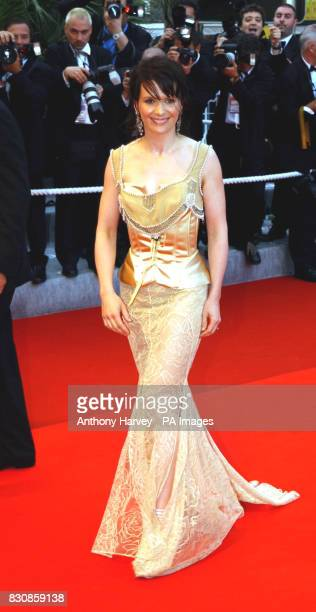 Actress Juliet Binoche arrives at the Premiere of 'PunchDrunk Love' at the Palais des Festival during the 55th Cannes Film Festival