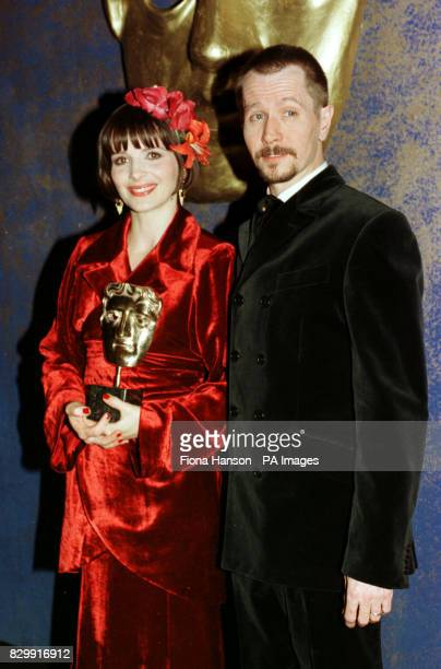 Actress Juliette Binoche and actor Gary Oldman at the BAFTA Award ceremony at the Royal Albert Hall where she won Best Supporting Actress for her...