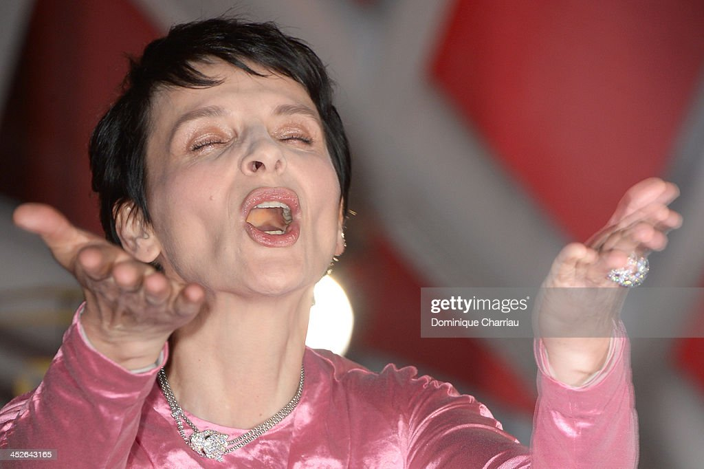 Actress <a gi-track='captionPersonalityLinkClicked' href=/galleries/search?phrase=Juliette+Binoche&family=editorial&specificpeople=209273 ng-click='$event.stopPropagation()'>Juliette Binoche</a> attends the 'A Thousand Times Good Night' premiere during the 13th Marrakech International Film Festival on November 30, 2013 in Marrakech, Morocco.