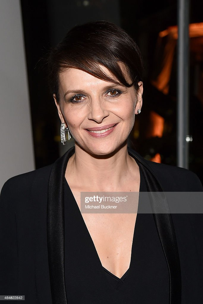 Actress Juliette Binoche attends the Warner Bros Pictures and Dolce Gabbana TIFF cocktail party during the 2014 Toronto International Film Festival...