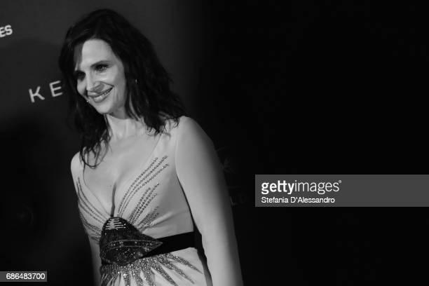 Actress Juliette Binoche attends Women In Motion Kering And Cannes Film Festival Official Dinner Photocall during the 70th Cannes Film Festival on...