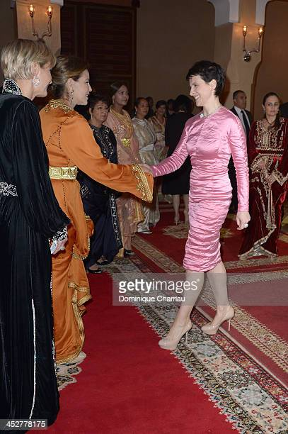 Actress Juliette Binoche is greeted by Princess Lalla Meryem of Morocco and Melita Toscan du Plantier as she attends the Royal Gala Dinner during the...